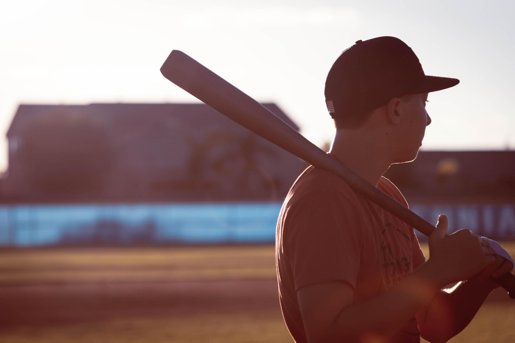 photo shows a young man with a baseball bat and